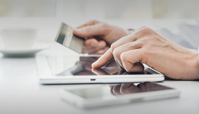 Making a payment in an app on a tablet